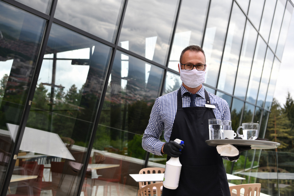Hospitality waiter wearing a mask